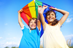 Little Girl And Little Boy Playing Kite Together Concept Royalty Free Stock Photography