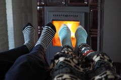 Children warm up. Little girl and little boy warm up by the fireplace stock image