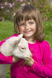 Little girl with little goat Royalty Free Stock Photo