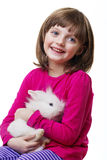Little girl and a white rabbit Royalty Free Stock Photo