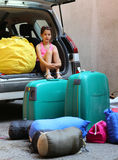 Little girl loads the car during the summer holidays Stock Photography