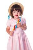 Little girl with lollipop. Studio shot Stock Photo
