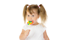 Little girl with lollipop Royalty Free Stock Photos