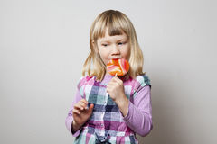 Little girl with lollipop Stock Images