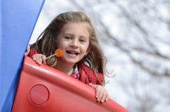 Little girl and lollipop Stock Photos