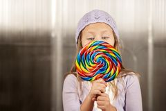 Little girl with a lollipop Stock Photos