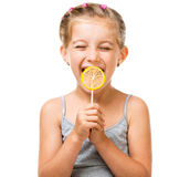 Little girl with lollipop. Adorable little girl with yellow lemon lollipop isolated over white background stock image