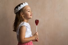 Little girl with a lollipop Royalty Free Stock Photography