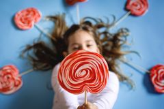 Little girl with lollipops. stock image