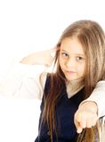 Little girl with long hair. With one finger to his temple turns to other shows ahead Stock Photo
