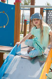 Little girl in denim peaky cap playing Royalty Free Stock Photos