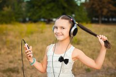 Little girl with long hair listening song Stock Images