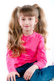 Little girl with long hair in a pink blouse Royalty Free Stock Image