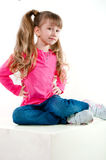 Little girl with long hair in a pink blouse Stock Photography