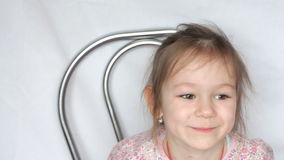 Little girl look at camera, smile and fool. Video of little girl look at camera, smile and fool stock footage