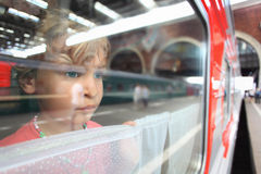 Little girl look from train window Stock Photography