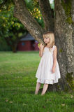 Little girl. Looking at apple Stock Photos