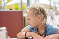 Little girl looking away Stock Image
