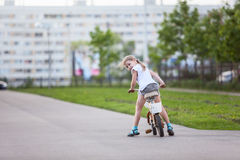 Little girl looking back when sitting bicycle Royalty Free Stock Photos