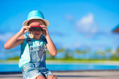Little girl looking through binoculars in sunny. Day royalty free stock images