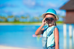 Little girl looking through binoculars in sunny. Day royalty free stock photos
