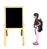 Little girl looking blackboard Royalty Free Stock Images