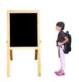 Little girl looking blackboard Royalty Free Stock Images
