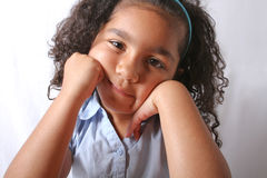Little girl looking bored Stock Photo