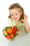 Little girl looking at a bowl of vegetables Royalty Free Stock Photos