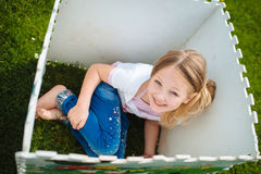 Little girl looking from the box and smiling Stock Photo