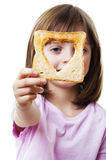 Little girl looking through  bread Stock Photo