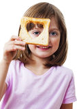 Little girl looking through a bread Royalty Free Stock Images