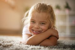Little girl looking at camera. stock photo
