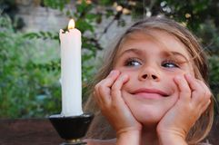 Little girl looking at the candle Stock Image