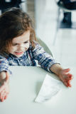 Little girl looking on check in restaurant. Royalty Free Stock Photo