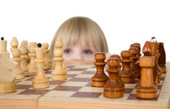 Little girl looking chess Stock Images