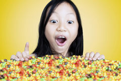 Little girl looking at colorful candies Stock Photo