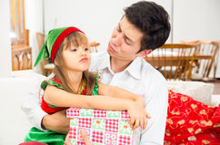 Little girl looking disappointed holding Christmas Royalty Free Stock Photos