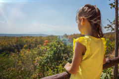 Little girl looking down from viewpoint Royalty Free Stock Images