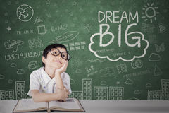 Little girl looking at dream big text Stock Photo