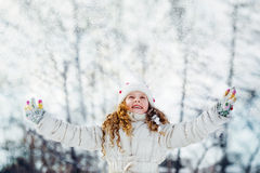 Little girl looking for falling snow. Royalty Free Stock Image