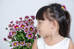 Little girl looking flowers Stock Photo