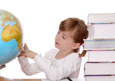 Little girl looking at globe. Isolated on white Stock Images