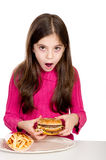 Little girl looking hamburger Royalty Free Stock Images