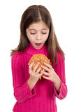 Little girl looking hamburger Stock Photo