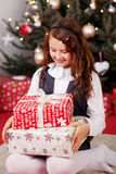 Little girl looking at her Christmas gifts Royalty Free Stock Image