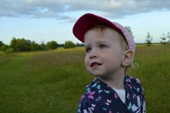 Little girl looking with interest into the distance Stock Photo
