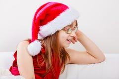Little girl looking like santa elf. Stock Images