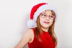 Little girl looking like santa elf. Royalty Free Stock Image