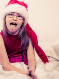 Little girl looking like santa elf. Royalty Free Stock Images